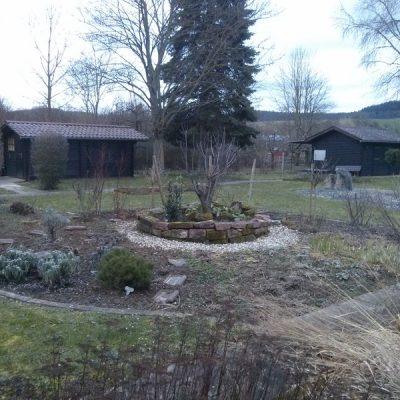 Beerensträucher und Kräutergarten
